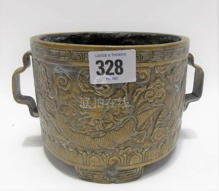 Chinese bronze censer cast in relief with two figures in a trellis garden to one side, the other