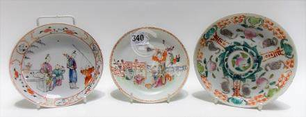 Three 18th Century Chinese famille rose saucer dishes, one painted with auspicious motifs, red