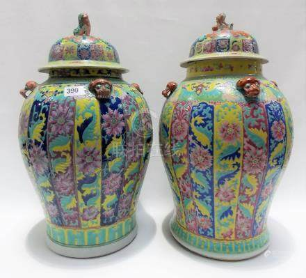 Good Chinese famille rose matched pair of lidded baluster vases, the domed lids surmounted by Fo