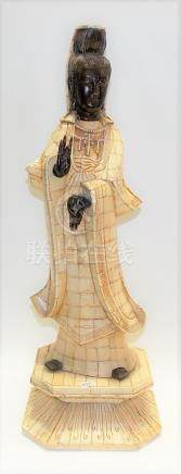 Chinese bone and horn figure of Guanyin, the carved horn head, hands and feet, the body carved