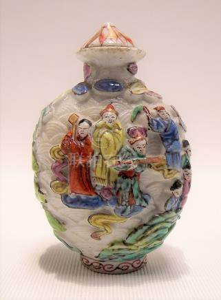 Chinese porcelain famille rose relief moulded snuff bottle decorated with figures in a lake