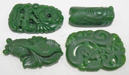 Four 20th Century Oriental spinach green jadeite panels, length of longest 5cm