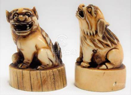 Pair of 19th Century Chinese ivory carved dog desk seals, height 5cm