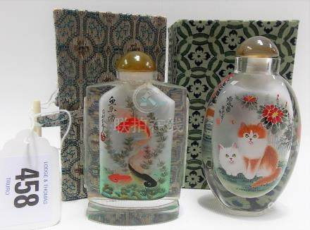 Two boxed 20th Century Chinese inside painted glass scent bottles and stoppers, one of flattened