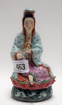20th Century Chinese porcelain figure of a seated Guanyin upon lotus flower and decorated with