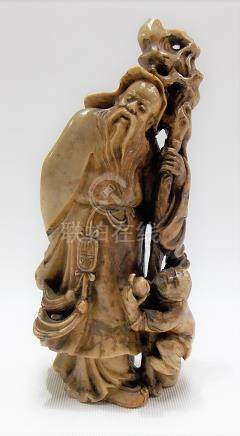 Good Chinese soapstone carving of a sage with staff, a boy with a peach at his feet, signed to the