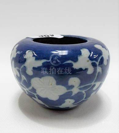 Chinese Ming Dynasty blue underglaze carved celadon ovoid brush pot, foliate scroll decorated upon a