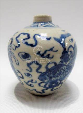 Chinese blue and white underglaze decorated ovoid bud vase decorated with three Chinese dogs with