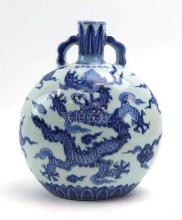 A Chinese blue and white terracotta moon flask of typical form decorated with dragons below and