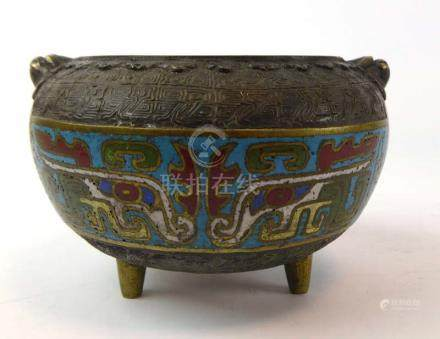 A bronze and enameled koro of typical form,