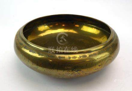 A Chinese brass 'singing' bowl of circular form, centrally decorated with a dragon, d.