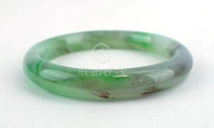 A green/purple jade bangle, internal d. 6.