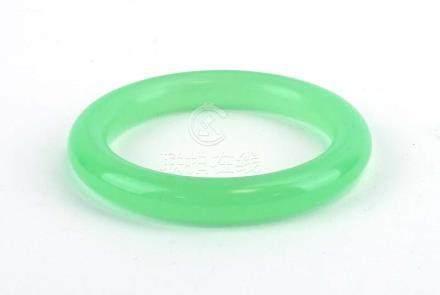 A pale green jade bangle, internal d. 5.