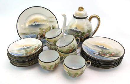 A Japanese eggshell part tea service, typically decorated with a view of Mount Fuji,