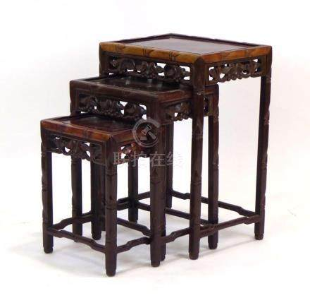 A nest of three Chinese carved tables, max w. 42.
