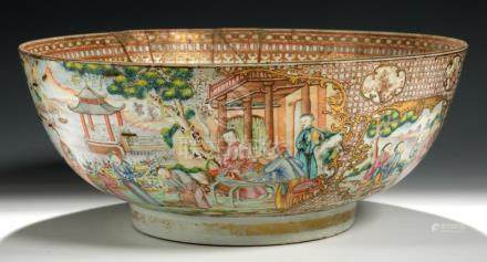 A CHINESE EXPORT PORCELAIN FAMILLE ROSE PUNCH BOWL, C1770 finely decorated with gilt panels of '