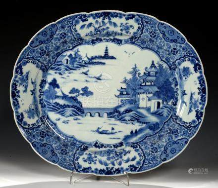 A CHINESE EXPORT PORCELAIN BLUE AND WHITE DISH, C1770-80 painted with a river scene, 42.5cm l++
