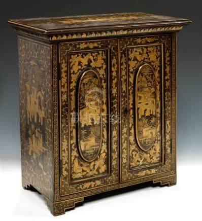 A CHINESE BLACK AND GOLD EXPORT LACQUER TABLE CABINET, EARLY 19TH C the panelled doors enclosing