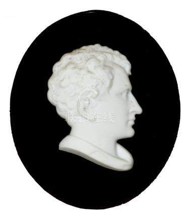 A BISCUIT PORCELAIN BAS RELIEF PORTRAIT OF LORD BYRON, EARLY 19TH C on oval black glass mount, 10.