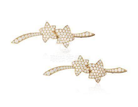 VAN CLEEF & ARPELS PAIR OF DIAMOND STAR BROOCHES