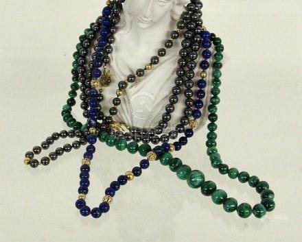 A LOT OF FOUR NECKLACES with lapis lazuli