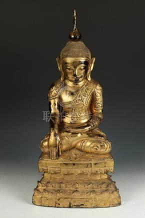 BURMESE CARVED AND GILT WOOD FIGURE OF SEATED BUDDHA ON THRO