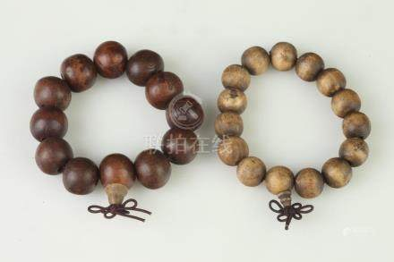 TWO CHINESE WOODEN PRAYER BEAD BRACELETS. - Larger interior: