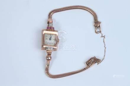 LADY'S 1940S RETRO 14K ROSE GOLD, DIAMOND, AND RUBY WRISTWAT
