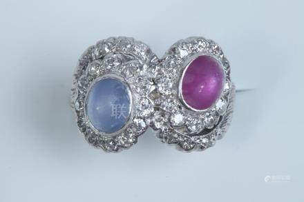 PLATINUM, DIAMOND, AND RUBY AND SAPPHIRE CABOCHON RING. earl