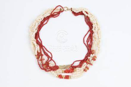 ELEVEN-STRAND FRESHWATER PEARL AND CORAL BEAD CHOKER WITH 14
