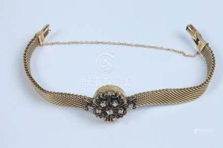 LADY'S 14K YELLOW GOLD AND DIAMOND BRACELET WATCH, by Belfon