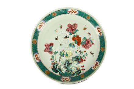 A LARGE CHINESE FAMILLE ROSE 'PEONIES' DISH. Qing Dynasty, 19th Century. Decorated with a central