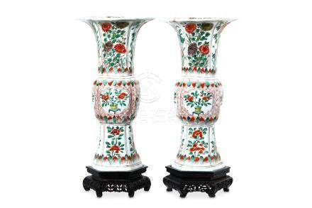 A PAIR OF CHINESE FAMILLE VERTE VASES, GU. Qing Dynasty, Kangxi period. Each with a moulded body