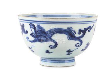 A CHINESE BLUE AND WHITE 'DRAGON' BOWL.  Late Ming Dynasty.   With a gently flared body painted with