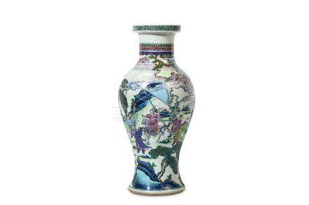 A CHINESE LATER-ENAMELLED BLUE AND WHITE VASE. Qing Dynasty, Kangxi period. The ovoid body rising