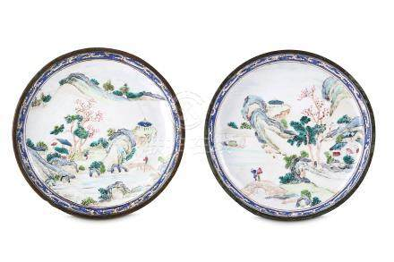 A PAIR OF CHINESE CANTON ENAMEL 'LANDSCAPE' SAUCERS. Qing Dynasty, 18th Century. Each painted with
