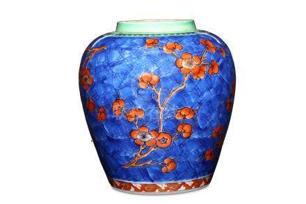 A CHINESE CLOBBERED BLUE AND WHITE 'PRUNUS' JAR. Qing Dynasty, Kangxi period. The ovoid, slightly