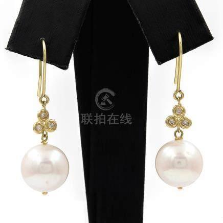 Pendientes de oro amarillo largos y pareja de perlas cultiva