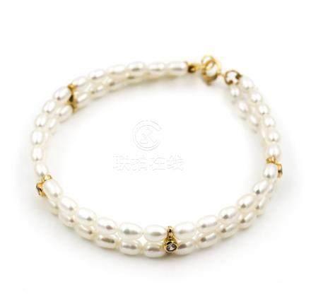 Pulsera de Oro Amarillo de 750 milésimas/18 kt con 60 Perlas