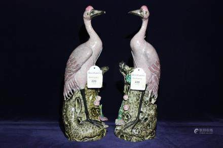 A PAIR OF FAMILLE ROSE HERONS