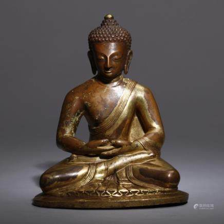 A BRONZE FIGURE OF SEATED SHAKYAMUNI