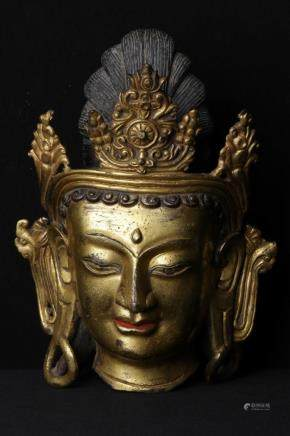 A GILT-BRONZE FIGURE OF BUDDHA HEAD