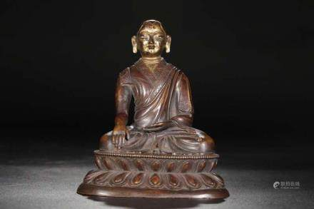 A BRONZE FIGURE OF GURU