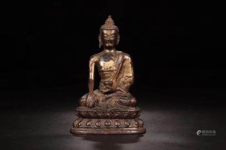 A GILT-BRONZE FIGURE OF BHAISAJYAGURU