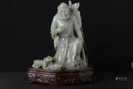 A JADE CARVED FIGURE OF BUDDHA