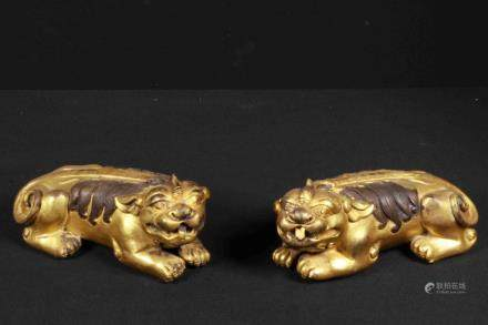 A PAIR OF GILT-BRONZE PAPER WEIGHT