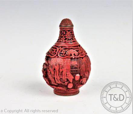 A Chinese cinnabar lacquer snuff bottle, Qianlong seal mark,