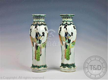 A pair of late 19th century Chinese famille vert vases, of fluted form, decorated with figures,