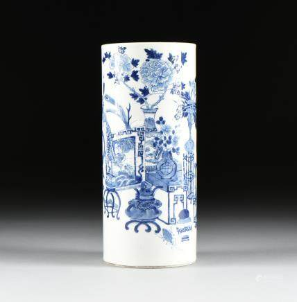 "A KANGXI STYLE BLUE AND WHITE GLAZED BITONG BRUSH POT, IN THE ""ONE HUNDRED ANTIQUES,"" MOTIF, CHINESE"