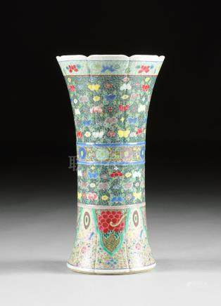 A LARGE UNUSUAL FAMILLE ROSE AND POLYCHROME ENAMELED GU SHAPED BEAKER VASE, the white slip glazed
